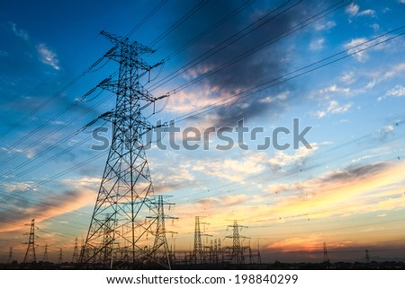 power transmission tower and the beauty of the sunset sky - stock photo