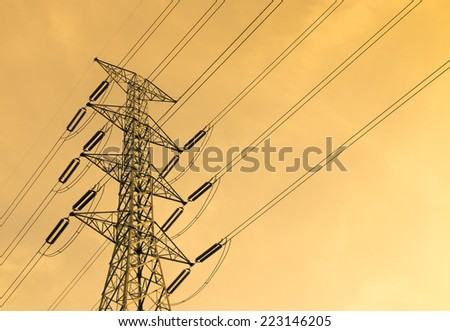 Power transmission tower at sunset - stock photo