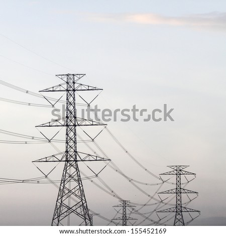 Power transmission tower line of electricity distribution - stock photo