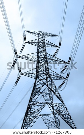 Power transmission tower with cables - stock photo