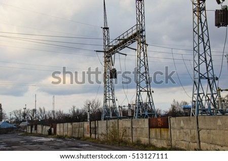 Power transmission towers and lines against sky and clouds