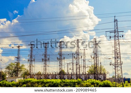 Power transmission towers at the substation railway - stock photo
