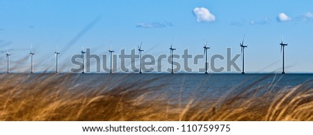 Power turbines in the sea - stock photo
