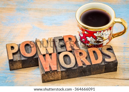 power words - text in vintage letterpress wood type printing blocks against painted wood with a cup of coffee - stock photo