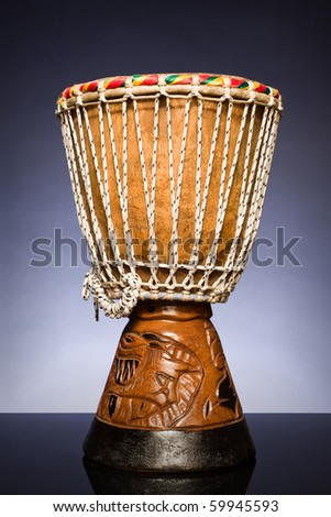 powerful African drum on a dark background - stock photo