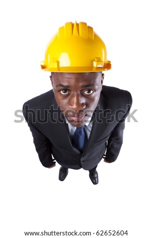 Powerful and happy african engineer businessman looking up (isolated on white) - stock photo