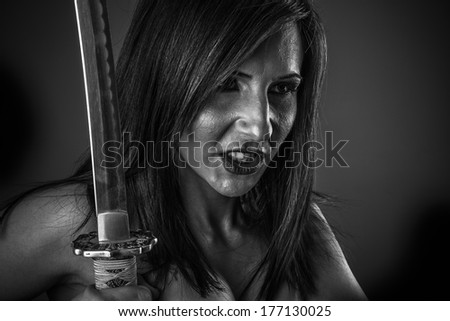 Powerful.Anime stylized brunette with short hair holding a katana sword with two hands - stock photo