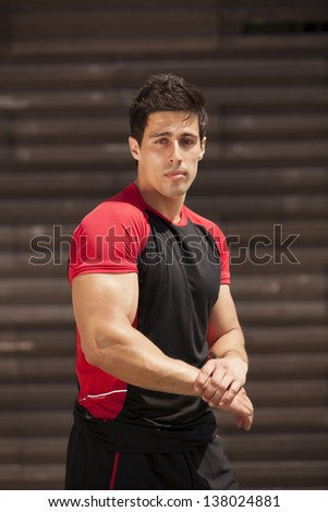 Powerful athlete male showing his muscles - stock photo