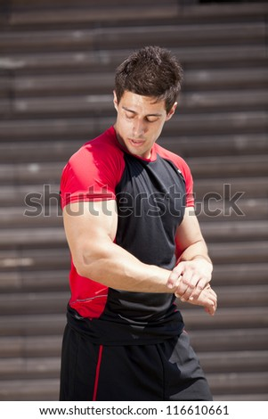 Powerful athlete showing his muscles - stock photo