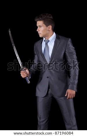 Powerful businessman holding a ninja sword (isolated on white) - stock photo