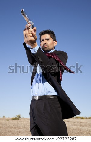 Powerful businessman with a gun in outdoor - stock photo
