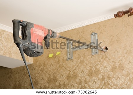 Powerful drill into the wall. Work on installing a new air conditioner. - stock photo