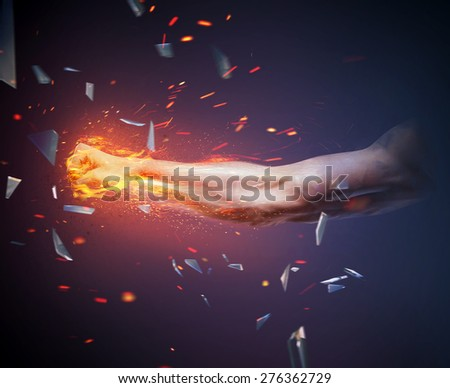 Powerful fist hitting target - stock photo