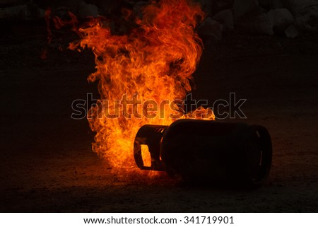 Powerful gas explosion with fire flame on black background - stock photo