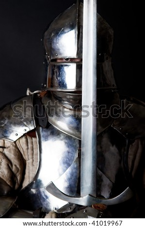 Powerful heavy fighter with sword and helmet - stock photo