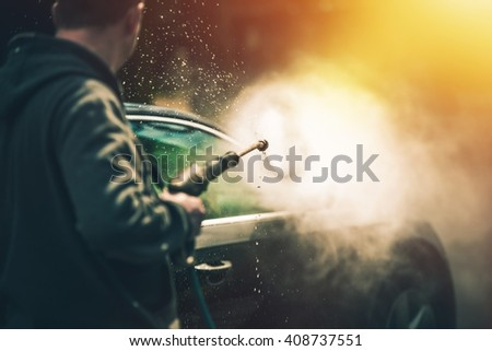 Powerful High Water Pressure Car Washing at Home. Car Cleaning. - stock photo
