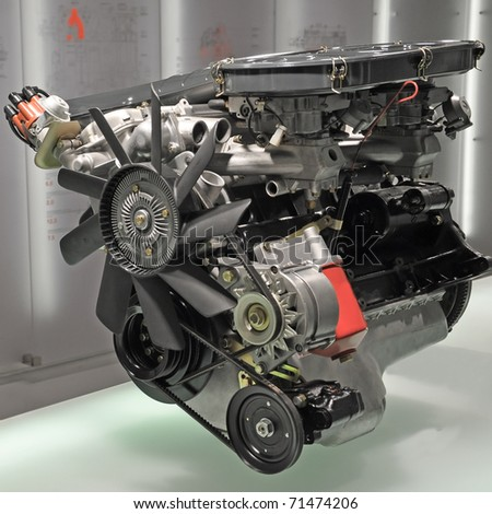 Powerful internal combustion car engine - stock photo