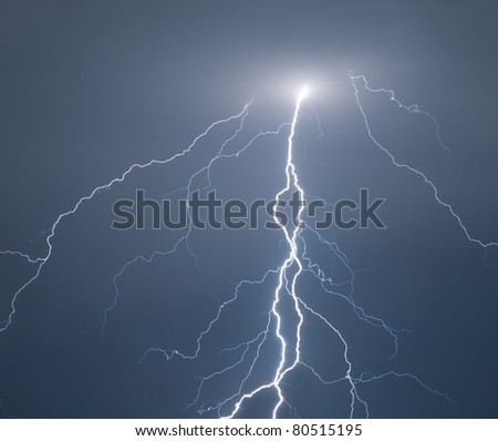Powerful lightning strikes the ground during big storm. Easily and seamlessly can be put over any other image. - stock photo