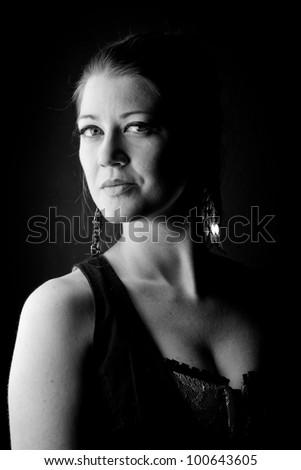 powerful low key shot of a beautiful blonde woman - stock photo
