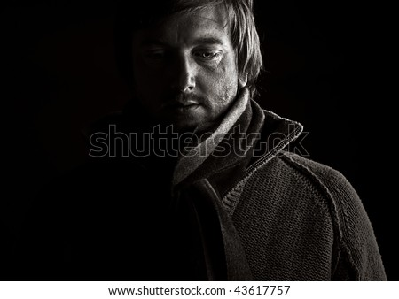 Powerful Low Key Shot of a Depressed Male - stock photo