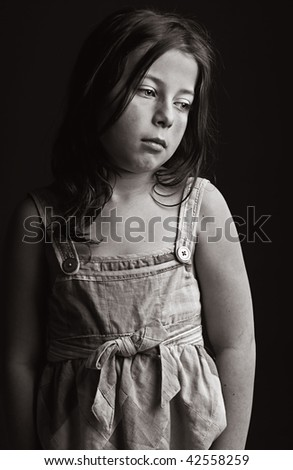 Powerful Low Key Shot of an Upset Young Girl - stock photo