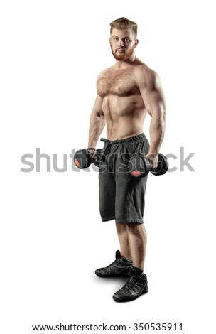 Powerful man with muscular build is training with the dumbbells. Isolated on white background.