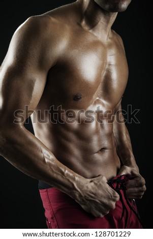 Powerful muscular man - stock photo
