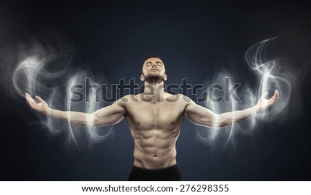 Powerful muscular man - stock photo