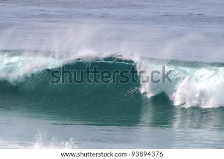 Powerful ocean wave breaking at the sea shore - stock photo