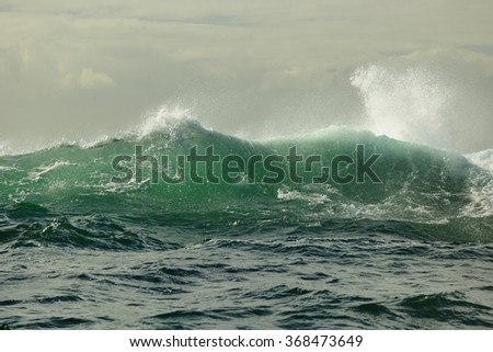 Powerful ocean wave breaking. Wave on the surface of the ocean. Wave breaks on a shallow bank. Natural background - stock photo
