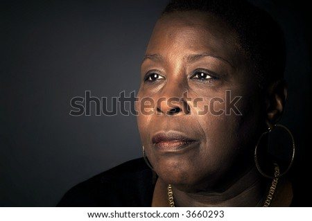 Powerful Portrait of a Afro American woman with wisdom - stock photo