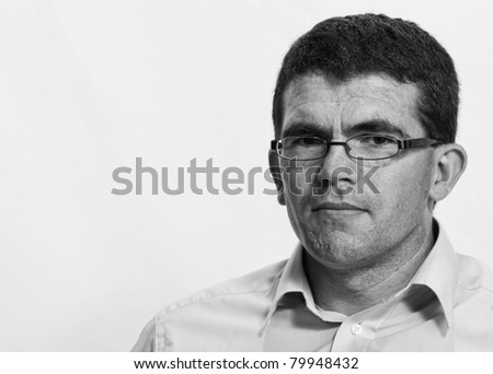 powerful portrait of a middle-aged man - stock photo