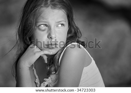 Powerful Shot of a Sad Child with Black Eye - stock photo