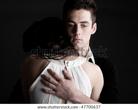 Powerful Shot of a Young Couple Embracing - stock photo