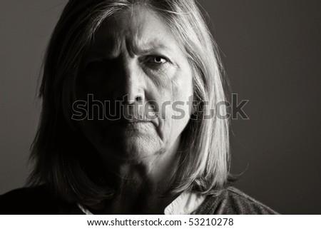Powerful Shot of an Unhappy Senior Lady - stock photo