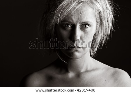 Powerful Shot of an Upset Blonde Woman - stock photo