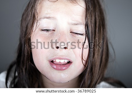 Powerful Shot of an Upset Child against Grey Background - stock photo