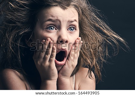 Powerful Shot of Scared Young Girl - stock photo