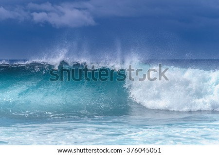 Powerful waves breaking along the shore - stock photo