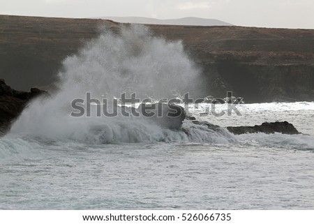 Powerful waves breaking on the rocky shore 2778(2)
