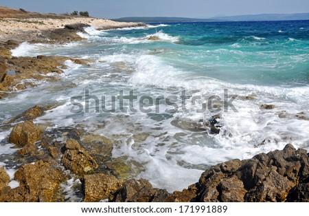 Powerful waves crushing on a rocky coastline - stock photo