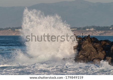 Powerful waves slam into the rocky coast of northern California, near Monterey Bay, south of San Francisco by about a 2 hour drive. Waves contain an enormous amount of renewable energy. - stock photo