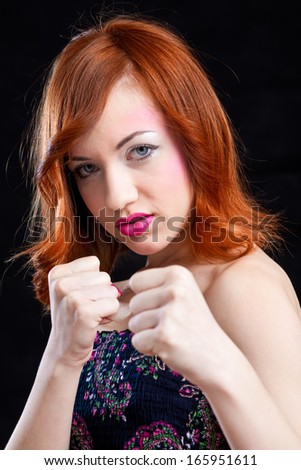 powerful woman with colorful make-up - boxing  - stock photo