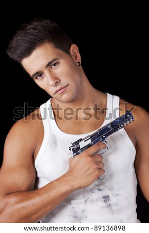 Powerful young man with a gun (isolated on black) - stock photo