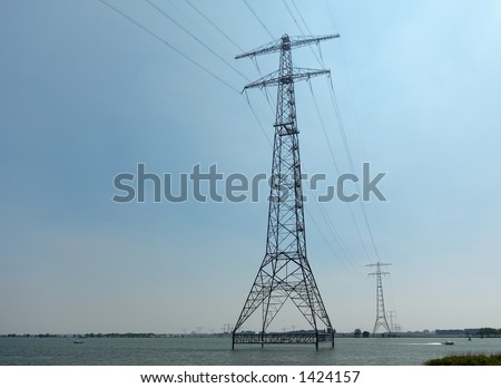 Powerlines above water - stock photo