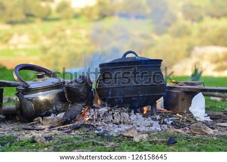 Poyke & kettle on fire - stock photo