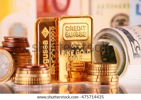 POZNAN, POLAND - APR 2, 2015: Gold has been widely used as money. For exchange purposes, mints produce standardized gold bullion coins, bars and other units of fixed weight and purity.