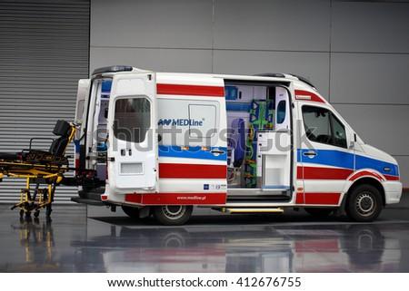 POZNAN, POLAND - APRIL 12. 2016: Rolling stretcher and  ambulance car on Poznan International Fair SALMED 2016, Poland. - stock photo