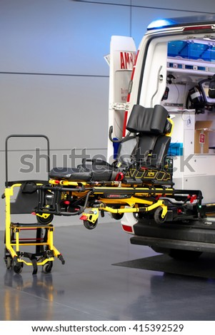 POZNAN, POLAND - APRIL 12. 2016: Rolling stretcher and  ambulance car on Poznan International Fair SALMED 2016, Poland.