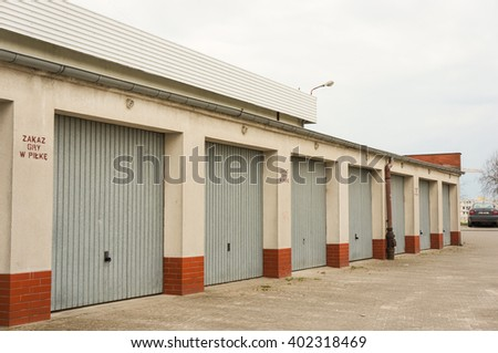 POZNAN, POLAND - APRIL 07, 2016: Row of garages with locked doors on a cloudy day